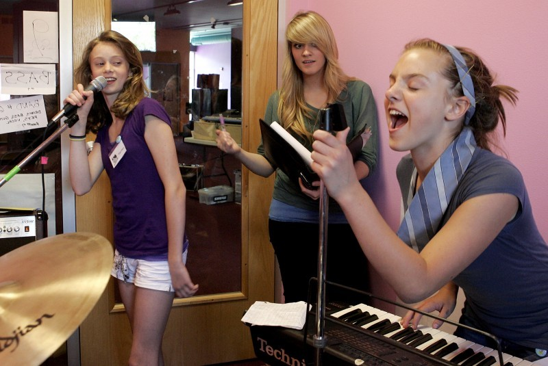 3 girls singing and recording music
