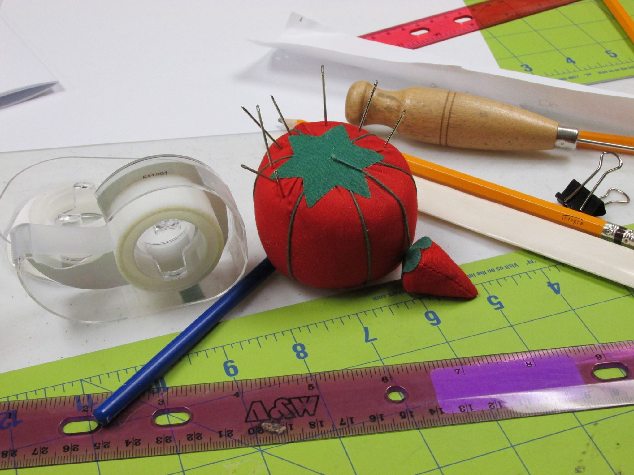 pincushion, ruler, tape and assorted crafting tools