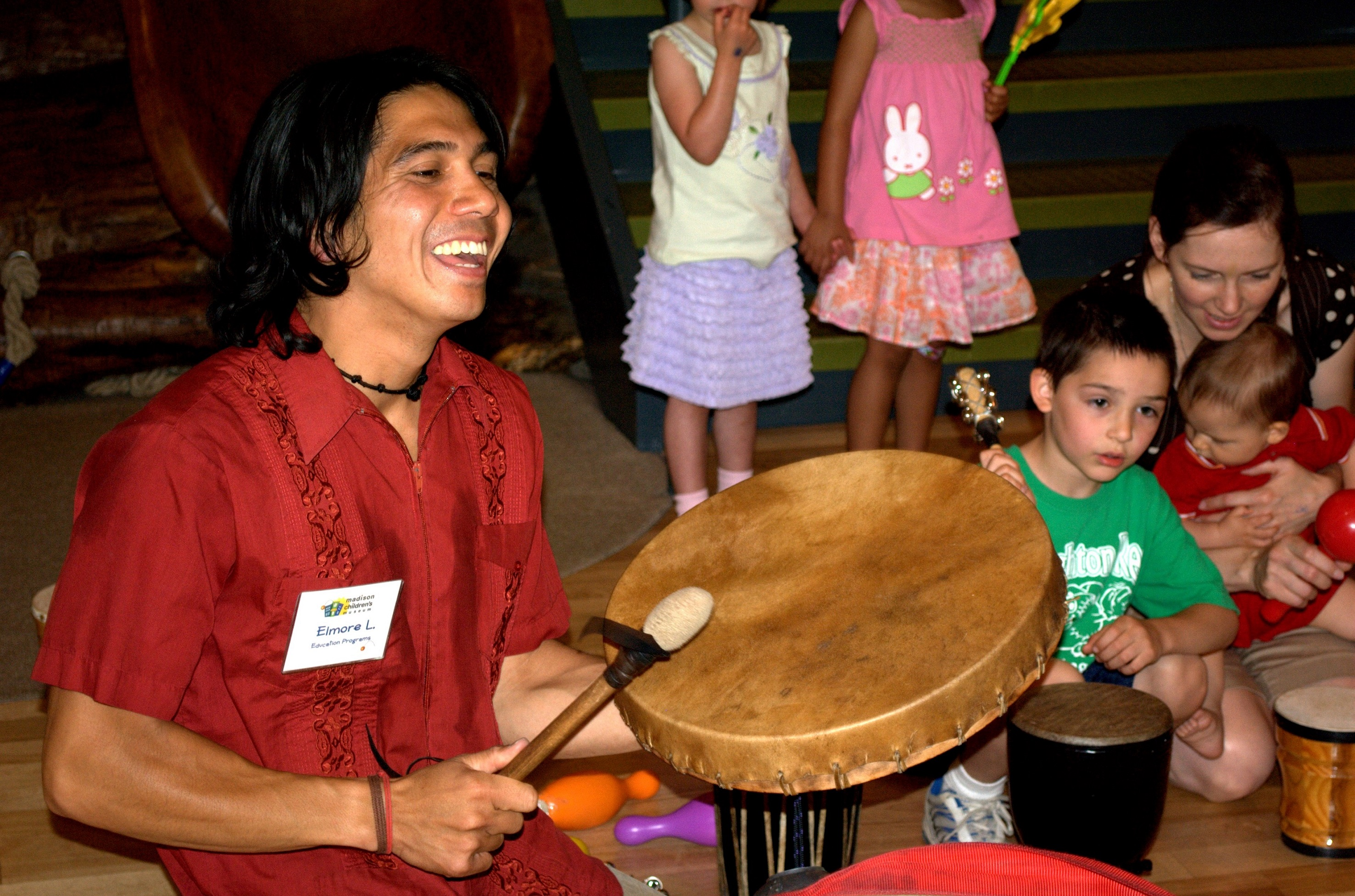 Elmore Lawson leads a drum circle with kids